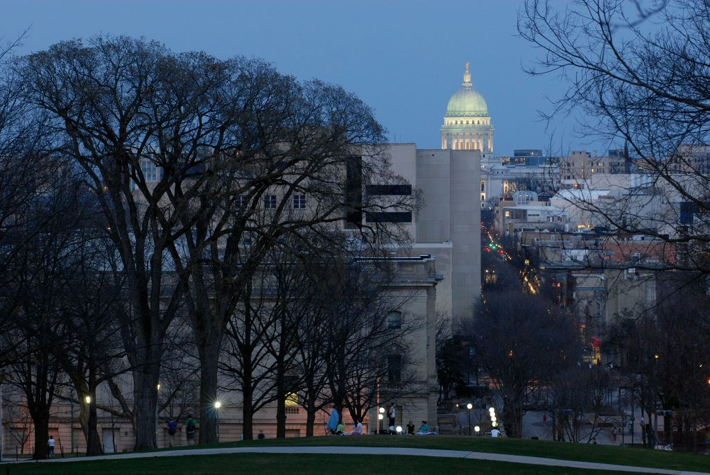 The illuminated dome of the Wisconsin State Capitol building at dusk glows on horizon in a nighttime view seen from Bascom Hill at the University of Wisconsin-Madison on March 26, 2007.©UW-Madison University Communications 608/262-0067Photo by: Jeff MillerDate: 03/07 File#: D200 digital camera frame 2993
